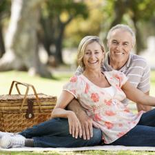 Couple has picnic outside to celebrate healthy hearing.